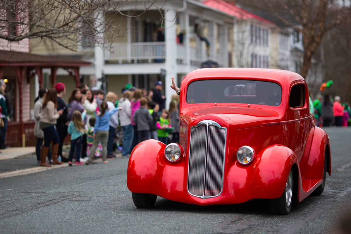 A red classic car from the parade