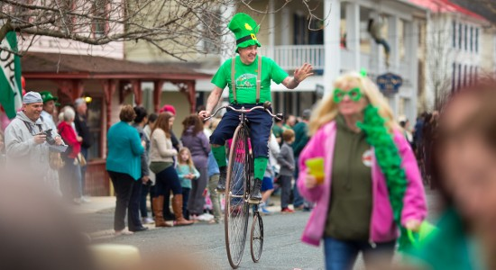 Unicyclist in the Chesapeake city St. Pat's Day parade